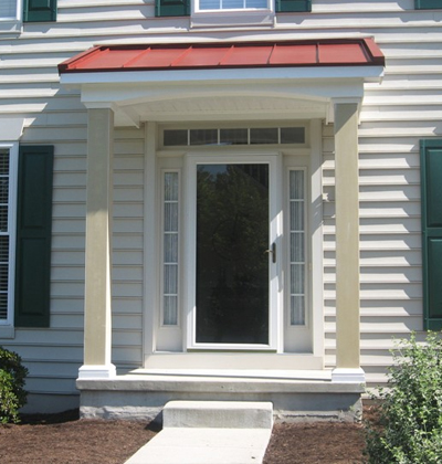 new portico overhang with red metal roof