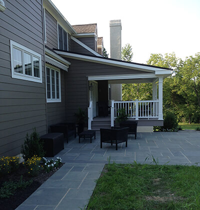 custom deck beside covered porch addition