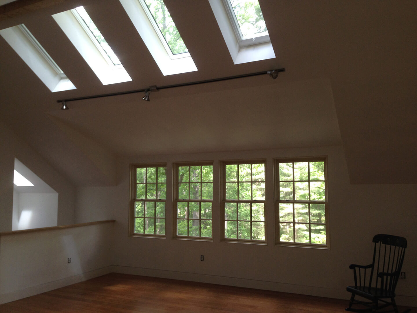interior view of second floor of custom garage with skylights and hardwood floors