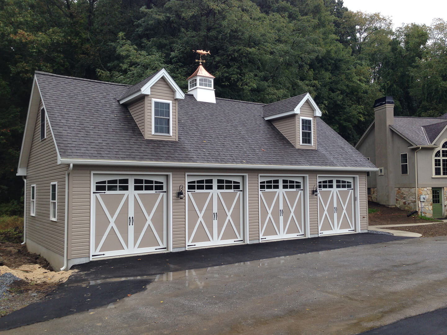 large four car garage in cape cod style with cupola