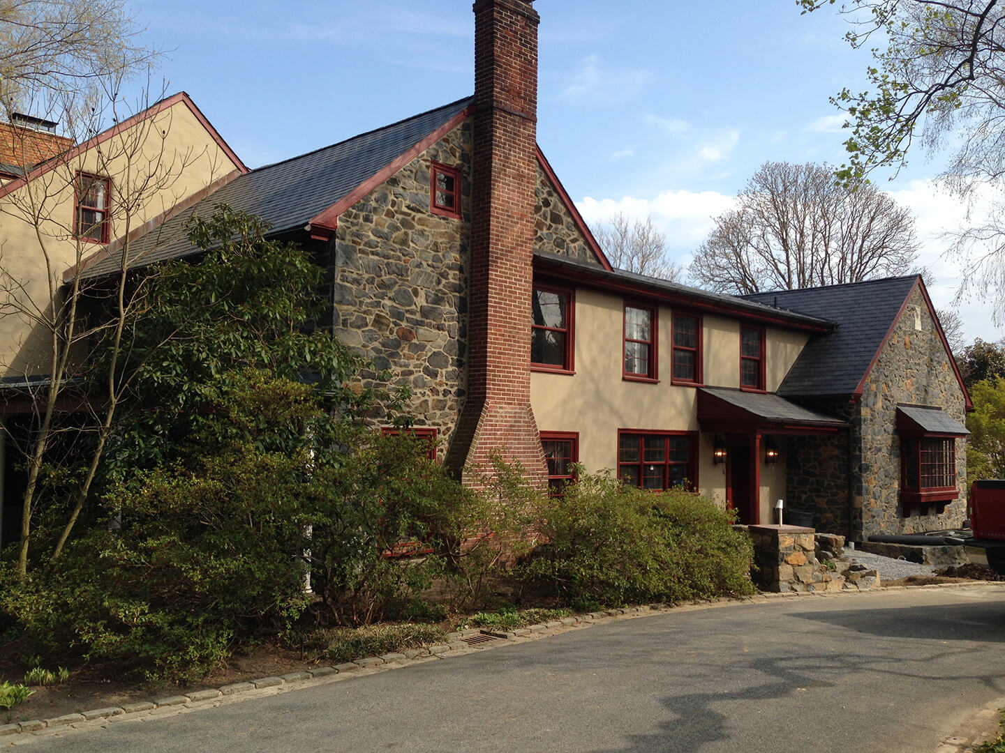 Historic Renovation with Stone, Brick, Stucco, & Mahogany Trim