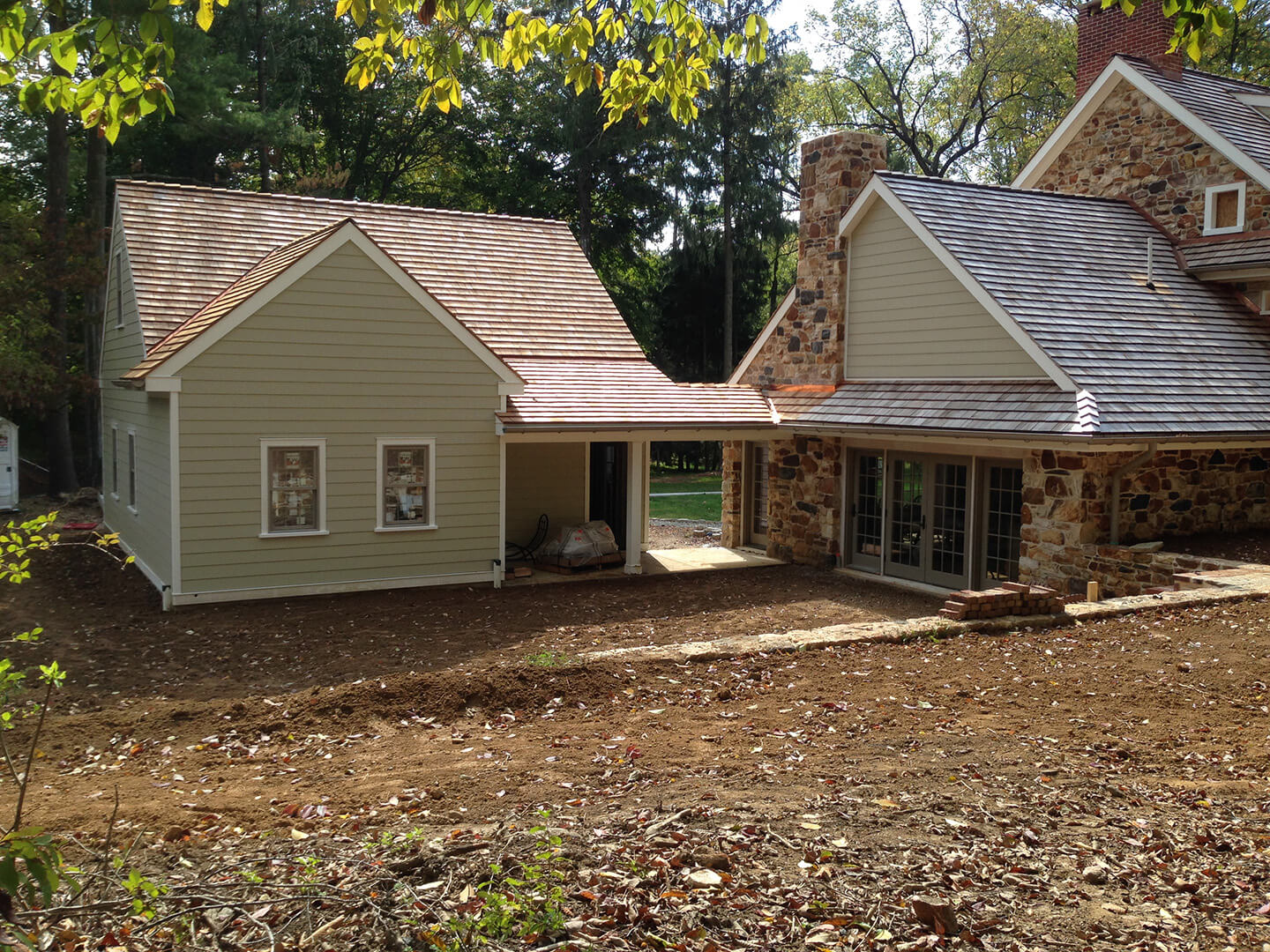 Renovation in Kennett Square with Stone, Fiber Cement Siding, & Cedar Roofing