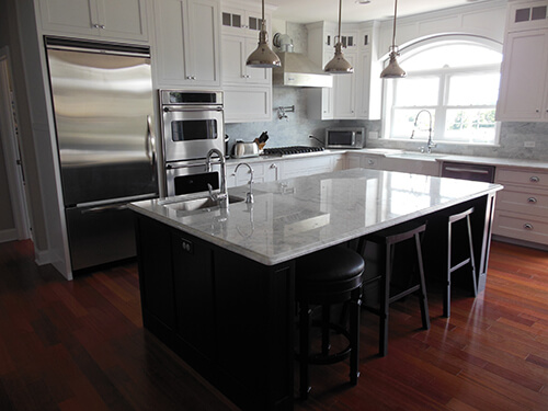 kitchen remodel with hardwood floors and marble countertops